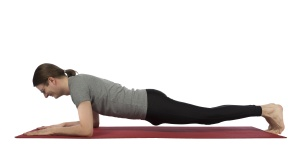 Man doing forearm plank pose in yoga