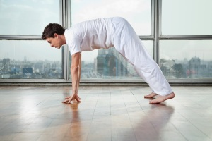 Man Practicing Yoga At Gym