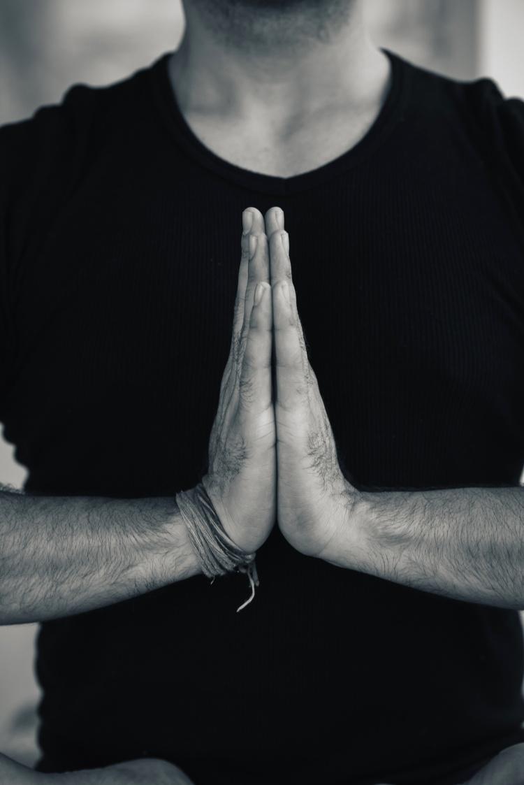Hands in Namaste prayer mudra by Indian man practicing yoga