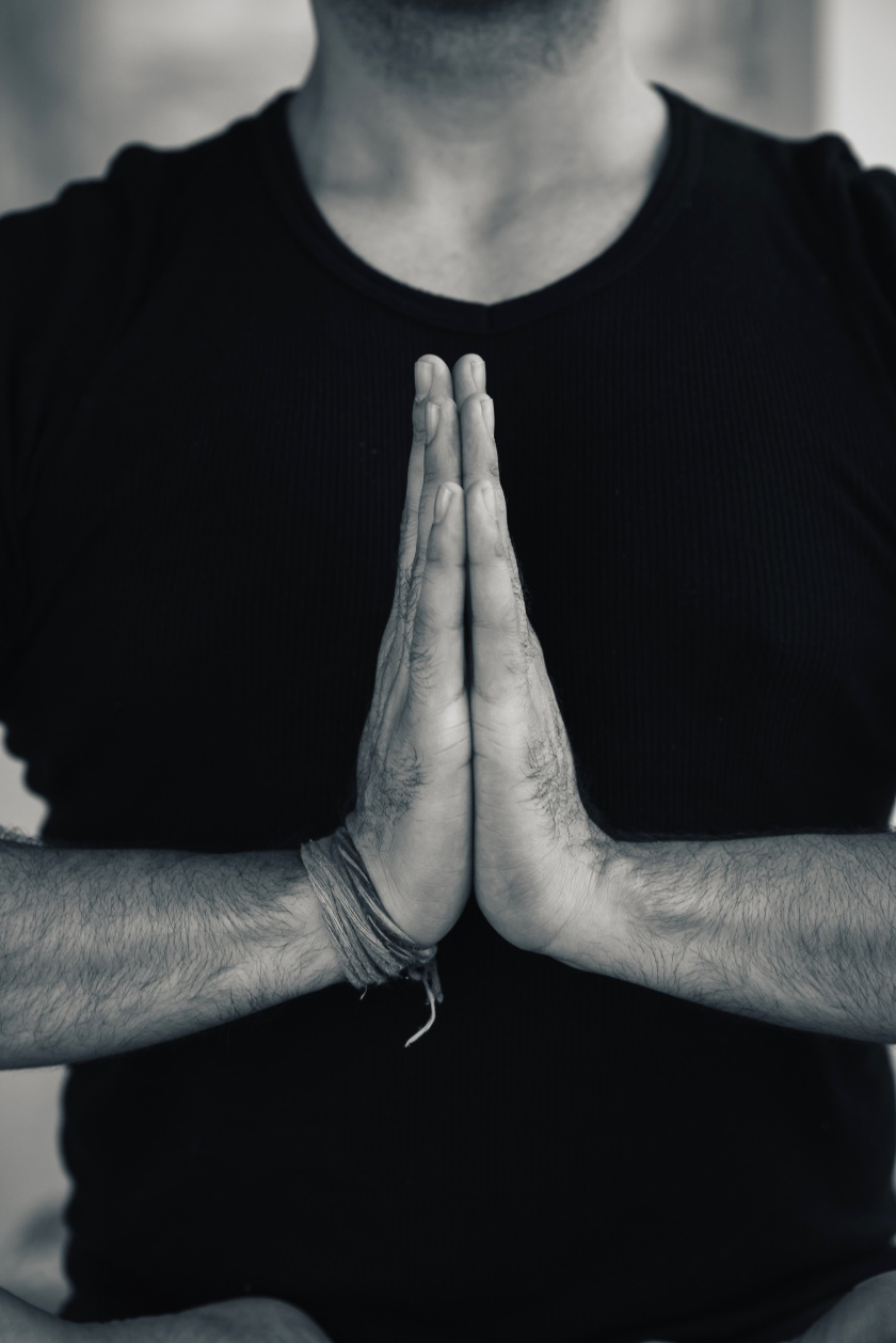 Hands in Namaste prayer mudra by Indian man practicing yoga